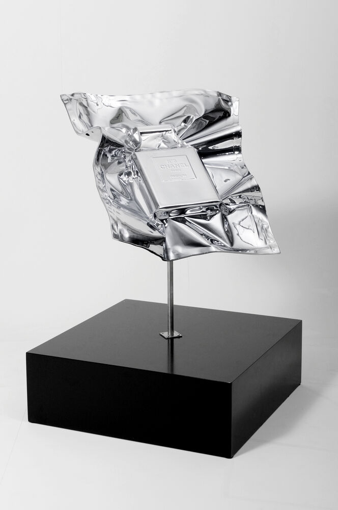 Vacuum sealed luxury good Chanel No. 5 perfume in chrome foil by artist Nikolai Winter