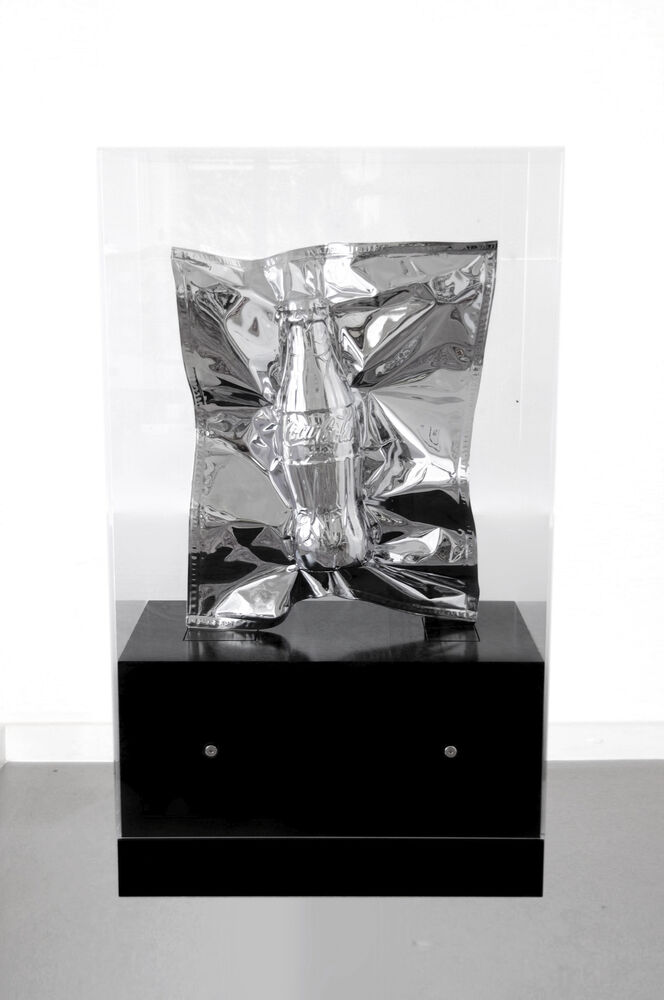 Vacuum sealed luxury good Coca Cola bottle in chrome foil by artist Nikolai Winter
