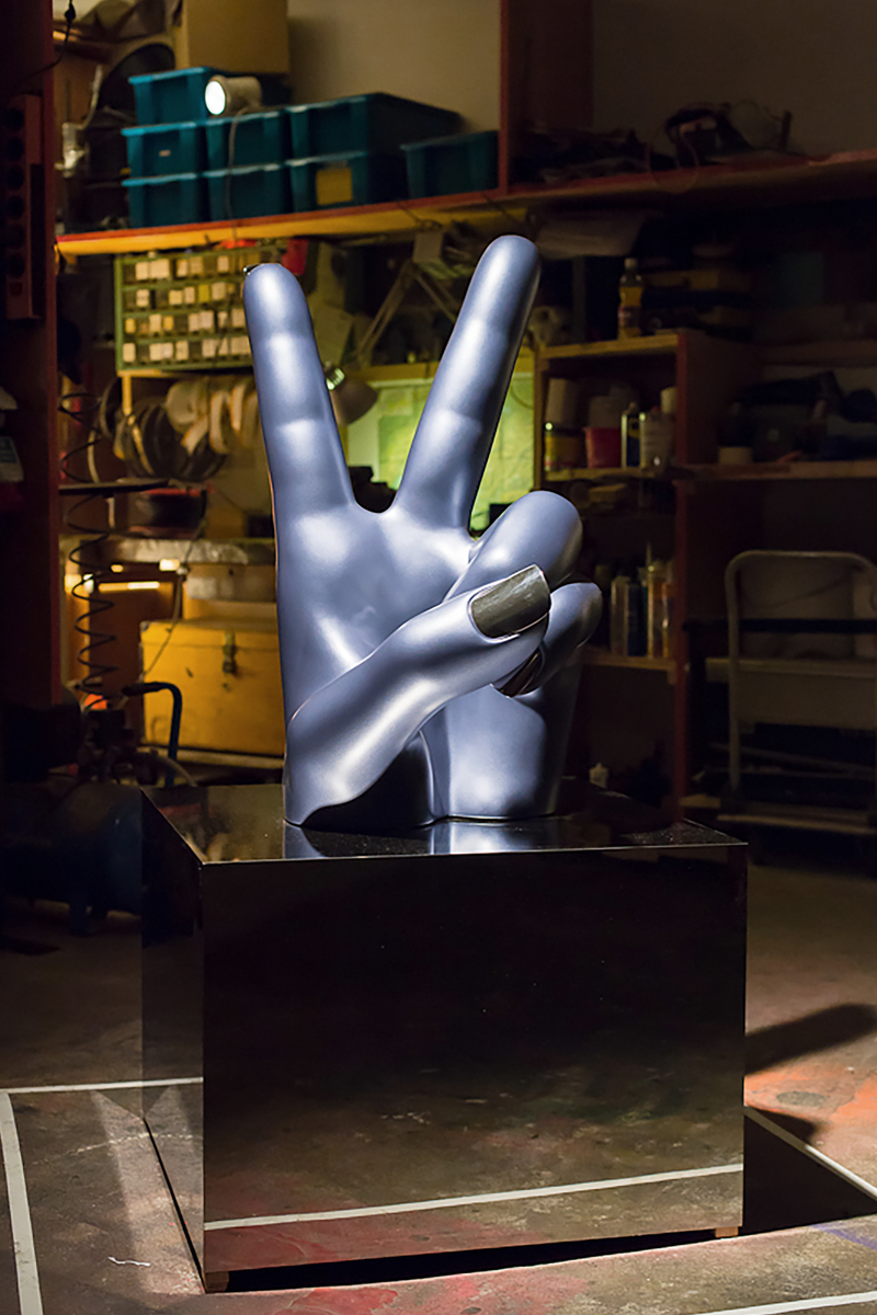 Victory hand gesture showing peace in cast aluminium by artist Nikolai Winter
