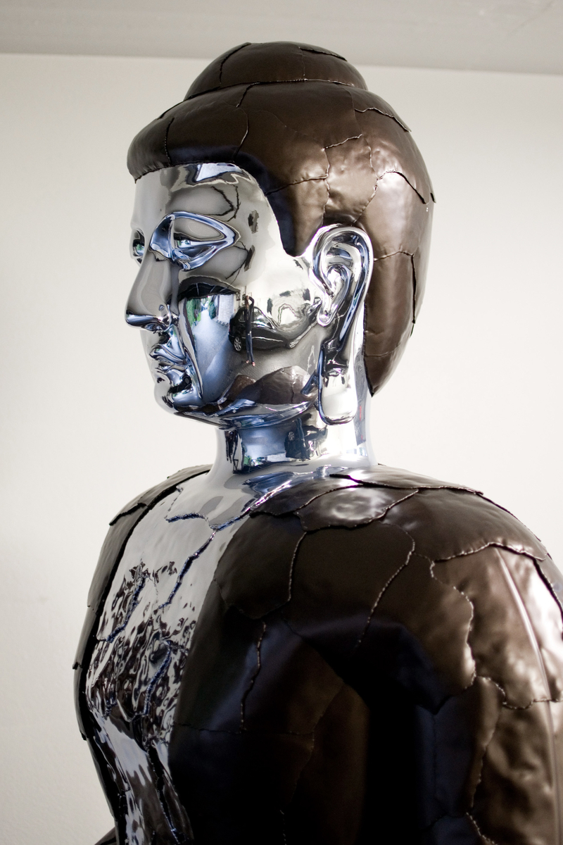 Transformed Rolls Royce Corniche into a Buddha sculpture with chrome body by artist Nikolai Winter